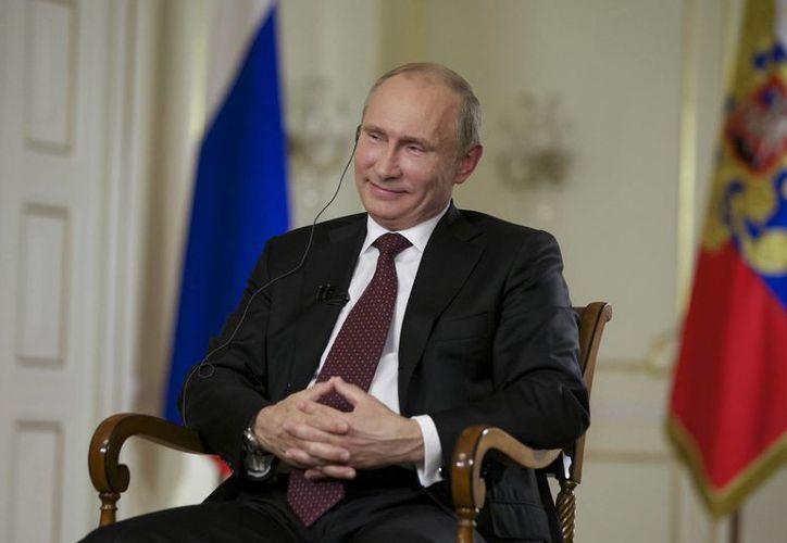"""Putin arguyó que Estados Unidos no extradita a criminales buscados por Rusia """"que torturan personas, trafican con personas, que tienen sus manos cubiertas de sangre"""". (Agencias)"""