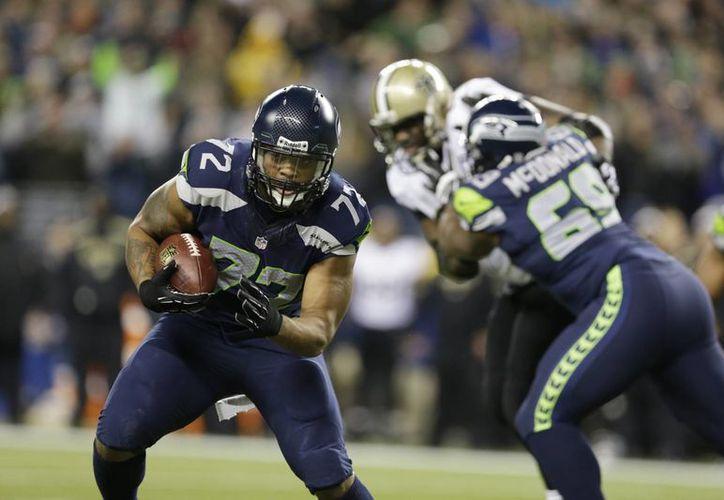 Instrumentos sismológicos al estadio registraron un temblor de magnitud 1 ó 2 cuando Michael Bennett (72) de Seahawks anotó un touchdown al recuperar un balón suelto. (Agencias)