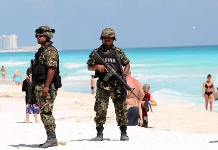 Las autoridades han reforzado la vigilancia incluso en la zona hotelera de Cancún. (Agencias)