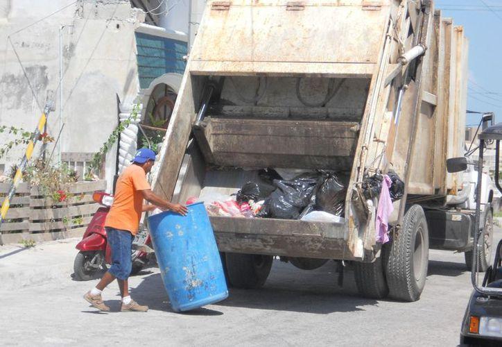 Subdividen en tres zonas la isla para que el sector empresarial cubra el impuesto por la recoja de basura. (Lanrry Parra/SIPSE)