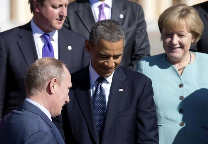 Putin (i) y Obama (c) aún no reconcilian sus diferencias acerca de atacar o no a Siria. (EFE)
