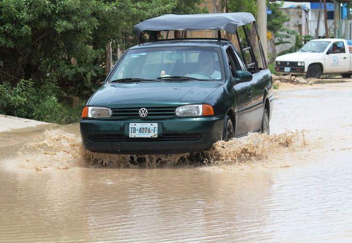 La temporada de verano que se esperaba fuera 'exitosa' para el ramo turístico, se vio empañada por las lluvias. (Foto: Octavio Martínez/SIPSE).