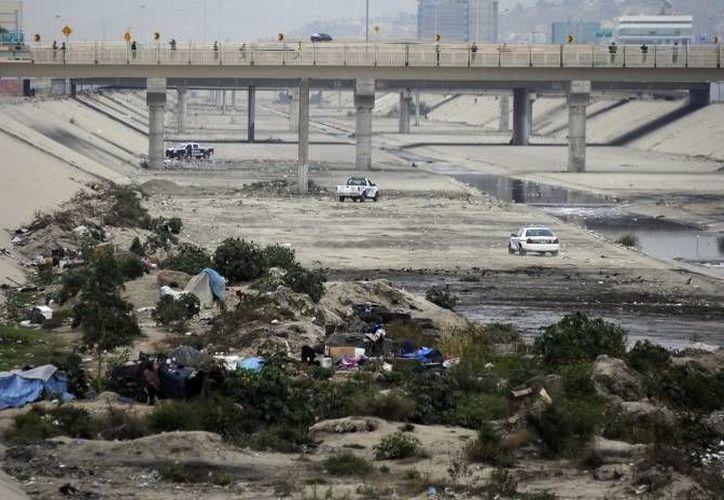 Operativo policiaco antiinmigrantes en la frontera EU-Tijuana. (Notimex/Foto de contexto)
