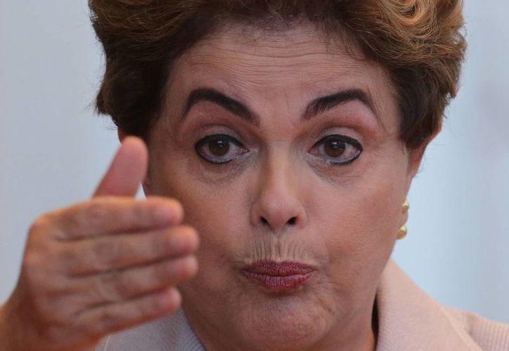 El legislativo de Brasil aún no decide si la presidenta Dilma Rousseff es o no separada del cargo de manera definitiva. (AP)
