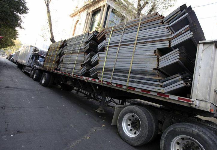 Los negocios buscarán evitar pérdidas como las ocurridas en la violenta gresca del 1 de diciembre de 2012. (Notimex)