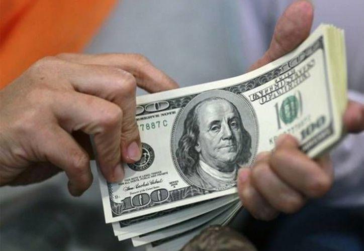 La mejoría en las remesas mexicanas en noviembre pasado estuvo por debajo del 2.85 esperado. (Agencias/Foto de archivo),