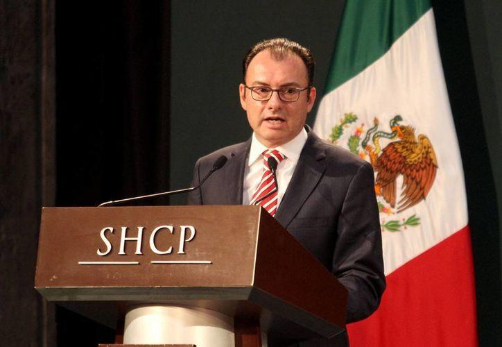 """El titular de Hacienda, Luis  Videgaray, mencionó que el sector de la vivienda es una """"industria prioritaria para generar empleos"""". (Archivo/Notimex)"""