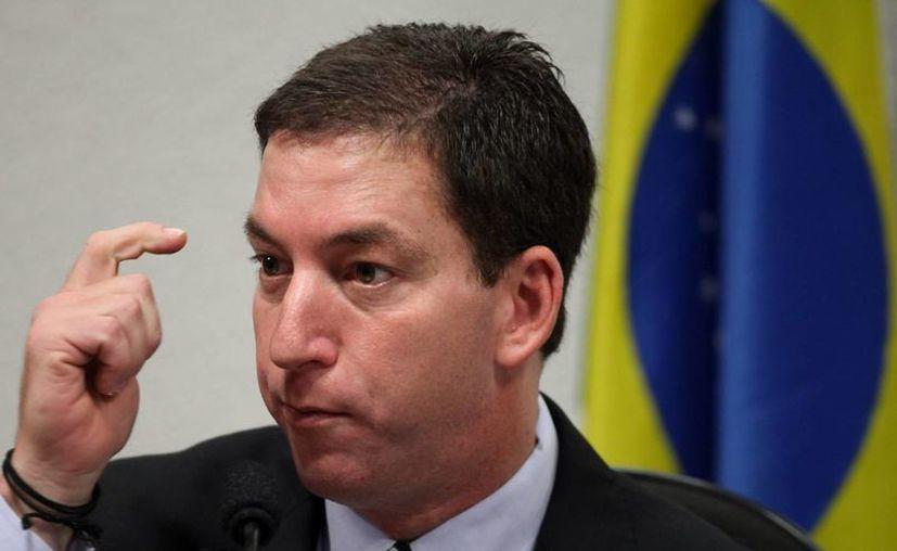 Greenwald (foto) se hizo famoso tras recibir miles de documentos clasificados del excontratista de la SNA, Snowden. (EFE)
