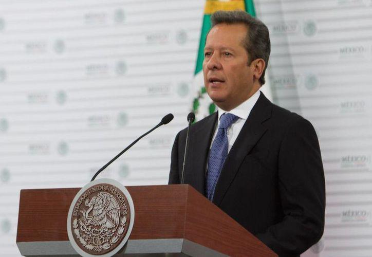 Eduardo Sánchez, vocero de la Presidencia, indicó que Peña Nieto está 'del mismo lado' que los padres de los 43 normalistas. (Notimex)