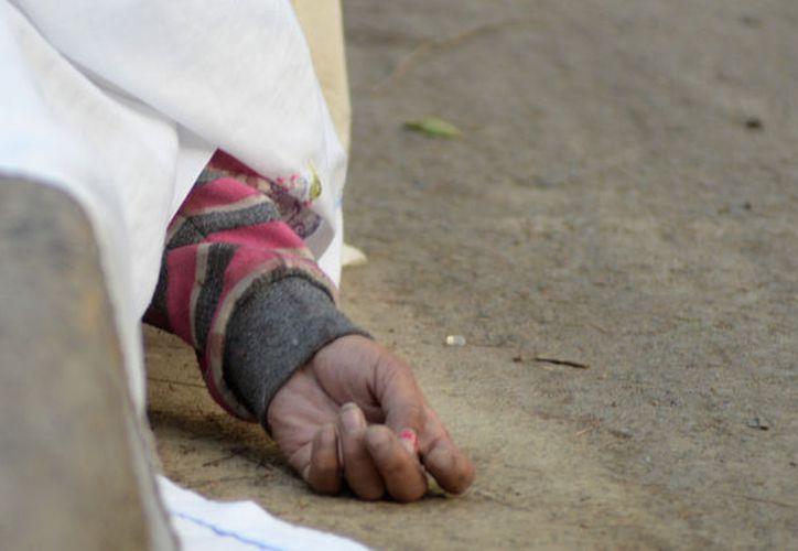 Habitantes de Tehuitzingo hallaron el cuerpo de Ana Elia, y pidieron auxilio de las autoridades. (Foto: Sin Embargo)