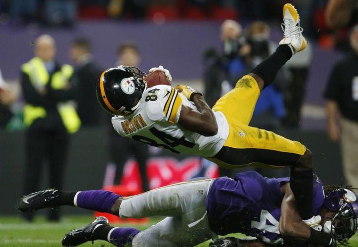 En el estadio de Wembley, Pittsburgh rompió la tradición de coronarse como vencedor en la apertura de una temporada. Vikings lo evitó. (Agencias)