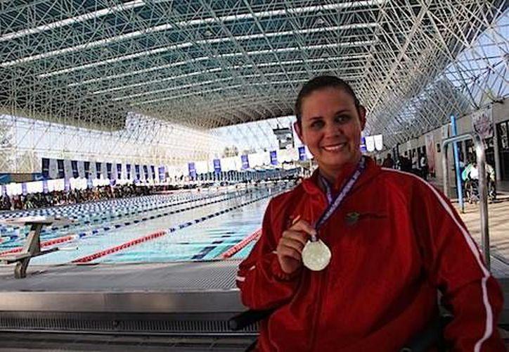 Nely Miranda Herrera consiguió su segundo registro, ya que el lunes logró el primero en los 50 metros libres. (noventaminutos.mx)