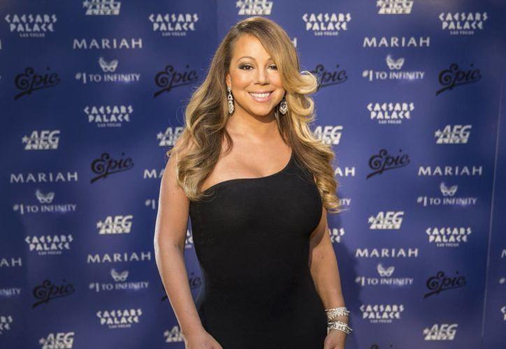 Mariah Carey cantará en los Premios Billboard a fin de mes. En la foto, a su llegada al hotel Caesar Palace en Las Vegas en abril. (Foto: AP)