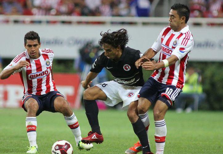 Al vencer al 'Rebaño sagrado', Xolos asegura el subliderato general y un sitio en la Copa Libertadores. (Notimex)