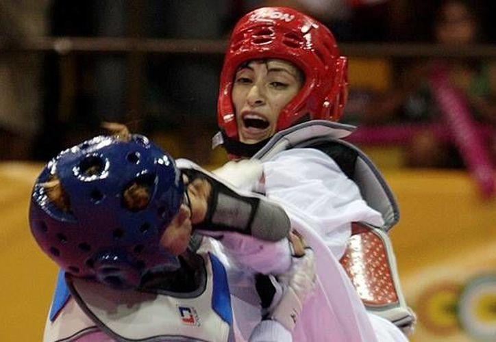 Manjarrez (casco rojo) puso su granito de arena para que México ya tenga ocho medallas en el Abierto de tae kwon do de Las Vegas. (mediotiempo.com)