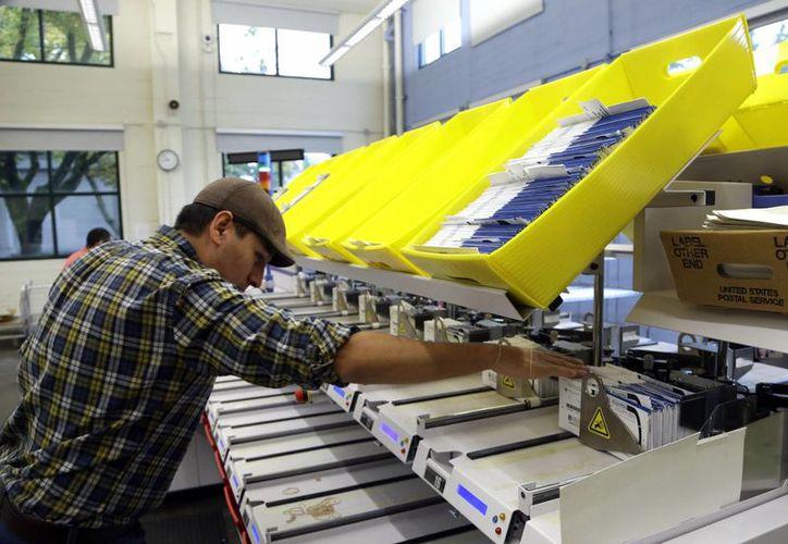 En Oregon los ciudadanos realizan su voto por correo. (Agencias)