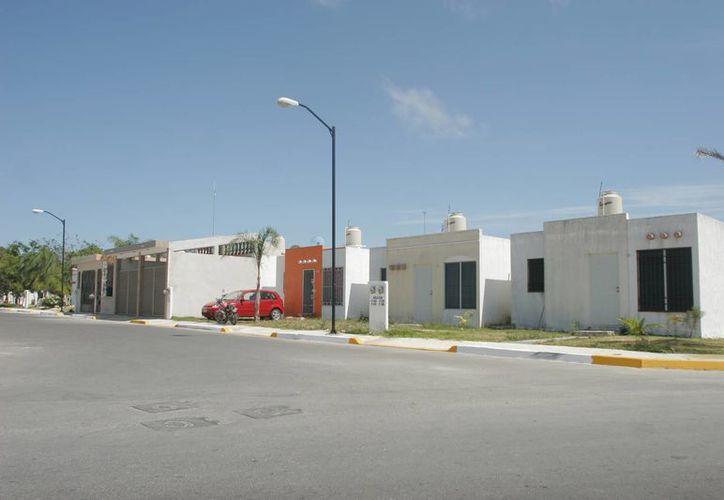 Se presentaron reformas legales, en busca de que las empresas dedicadas a la construcción y comercialización de viviendas, cumplan con una serie de criterios. (Eddy Bonilla/ SIPSE)
