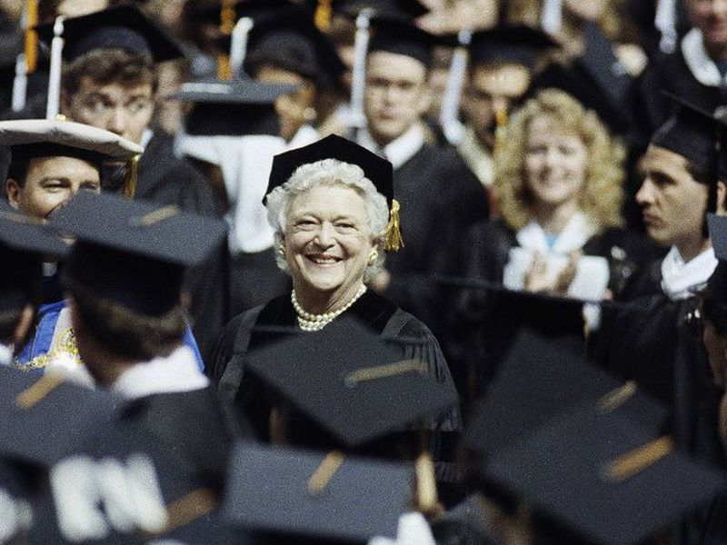 former first lady Barbara Bush, center, smiles while being greeted by graduates at St. Louis University in St. Louis, Mo. (AP)