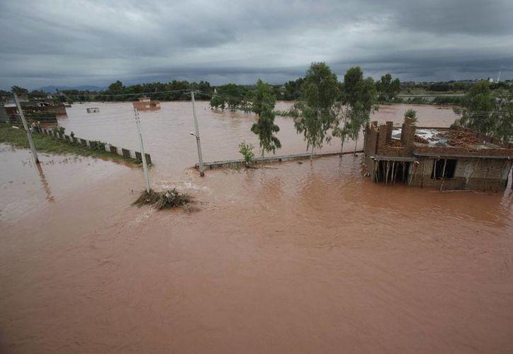 Area inundada en las afueras de Islamabad, Pakistán.(Foto: AP)