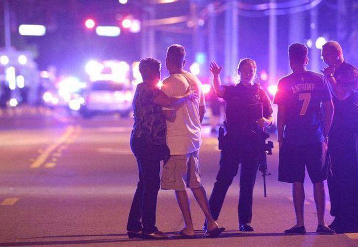 La masacre en un bar gay de Orlando ha conmovido al mundo entero y las historias de los sobrevivientes muestran el infierno que se vivió la madrugada de ese trágico domingo. (AP)