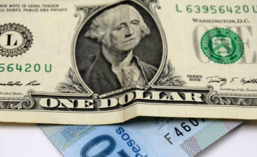 Desde el viernes pasado y durante el fin de semana feriado el dólar fluctuó entre 19.90 y 20 pesos. (SIPSE.com)