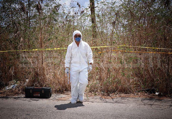Hallan cadáver de presunto suicida cerca del Periférico de Mérida. (Foto: Victoria González/SIPSE))