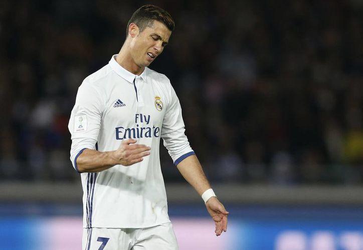 Cristiano Ronaldo regresará a las canchas hasta el próximo fin de semana, cuando el Real Madrid enfrente a Granada en el torneo de la Liga de España.(Shizuo Kambayashi/AP)