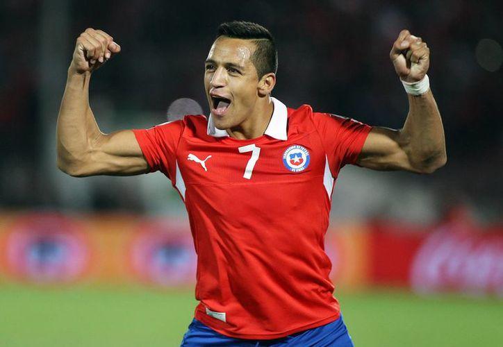 Como regalo de Navidad, el jugador chileno Alexis Sánchez, inaugurará la calle con su nombre. (EFE/Archivo)