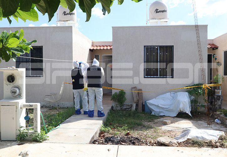 La vivienda en la que fue hallada el cuerpo, esta tarde de sábado. (Aldo Pallota/ SIPSE)