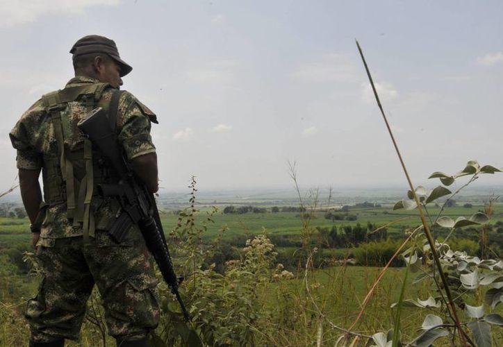 Expulsados de las Fuerzas Armadas a 5 militares por seguir ilegalmente a los delegados del gobierno en el proceso de paz con las FARC en Cuba. (Archivo/Agencias)