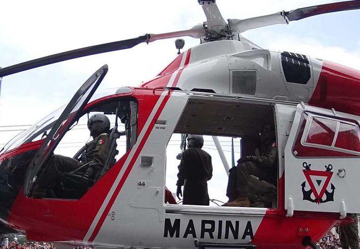 Un enfrentamiento entre marinos y narcotraficantes dejó saldo de 2 muertos. Durante el enfrentamiento, los marinos utilizaron una aeronave para repeler el ataque de los delincuentes. La imagen está utilizada sólo con fines ilustrativos. (Archivo/NTX)