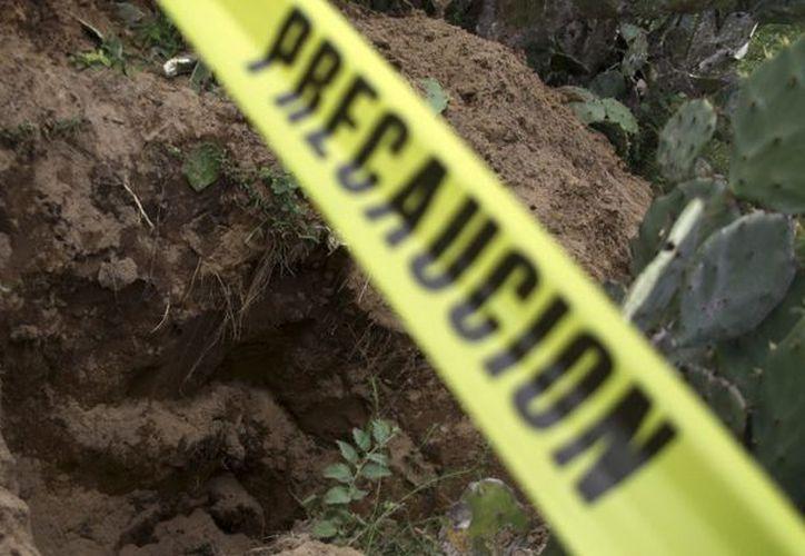 Fueron localizadas en las faldas del Matlalapan, que ya ha sido escenario de otros hallazgos de restos sepultados. (Cuartoscuro)
