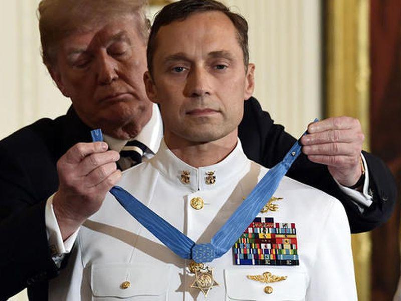 PresiDenT Donald Trump awards the Medal of Honor to Master Chief Special Warfare Operator Britt K. Slabinski. (AP)