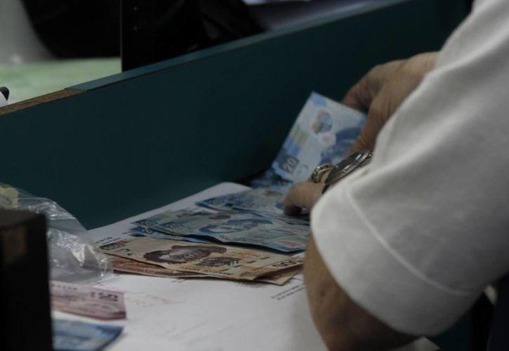 """Con la entrada en vigor de la ley """"antilavado de dinero"""", los actos ilícitos han incrementado. Quintana Roo se coloca en el octavo lugar en la práctica de esta actividad. (Israel Leal/SIPSE)"""