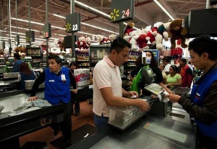 En el documento, el organismo mundial destacó que ha  aumentado la confianza del consumidor y el interés en las inversiones. (Archivo/AP)