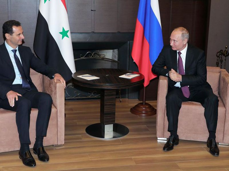 Russian President Vladimir Putin, right, listens to Syrian President Bashar al-Assad during their meeting in the Black Sea resort of Sochi, Russia.