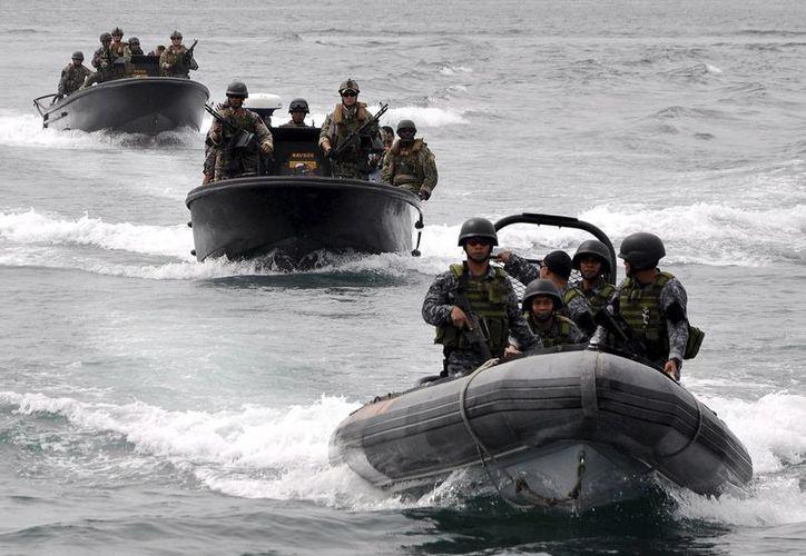 Casi todos los tipos de embarcaciones de superficie y submarinas, cazas, helicópteros y aviones de reconocimiento de la Armada de EU estarán presente. (Archivo/EFE)