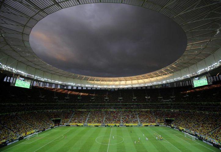 """El estadio nacional """"Mane Garrincha"""", que fue sede de la Copa Confederaciones, también albergará algunos partidos del Mundial de 2014. (Agencias)"""