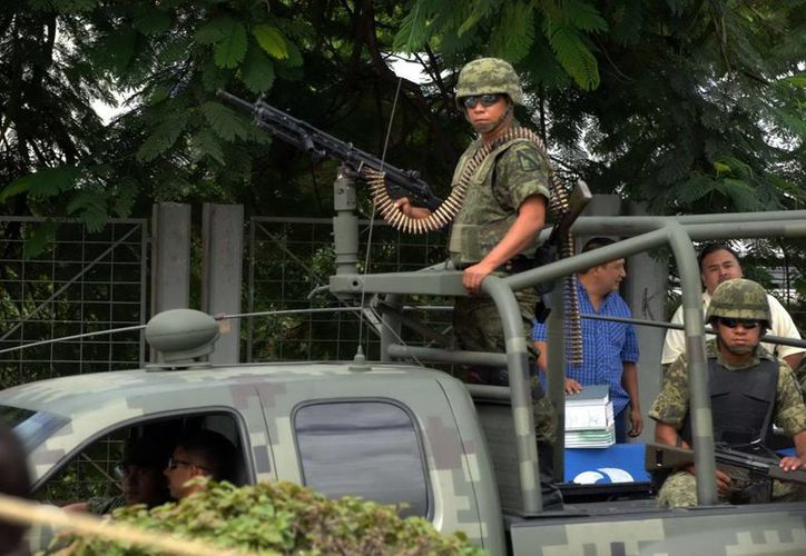 Ante el llamado de alerta, el Ejército mexicano llegó, pero no detuvo a nadie. (Archivo/Notimex)