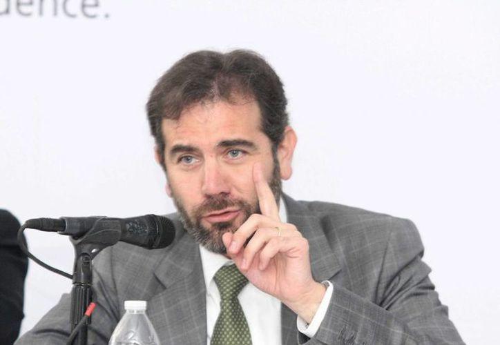Lorenzo Córdova explicó que a cada copia que entregan del listado nominal se le asigna una huella digital. (Archivo/Notimex)
