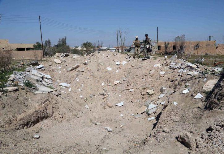 Así luce lo que fuera el mausoleo del dictador Saddam Hussein, en Irak, dañado a consecuencia de enfrentamientos entre autoridades y el Estado Islámico. (Foto: AP)