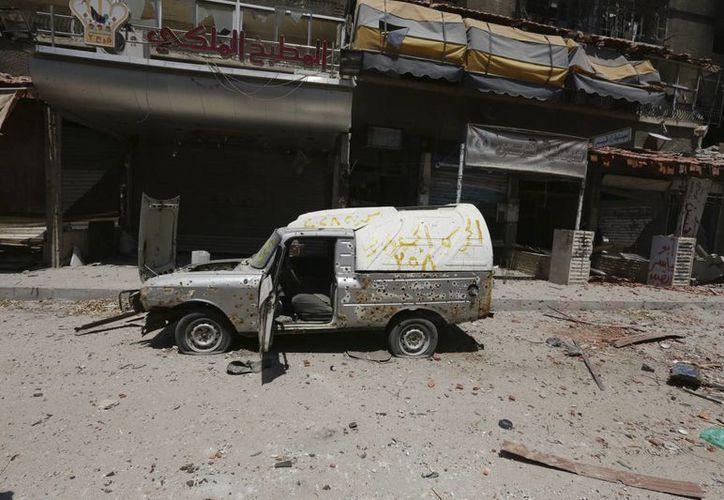 Vista de una calle destruída en Mleha, en las afueras de Damasco, el viernes 15 de agosto de 2014. Desde que estalló el conflicto en Siria, en 2011, por lo menos cuatro estadounidenses reclutados por los grupos islamistas han muerto en la lucha. (EFE/Archivo)