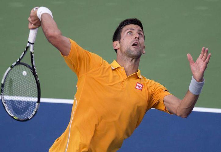 Con una hora y 50 minutos de acción, el serbio Novak Djokovic venció por parciales de 6-3 y 7-6 (7/4) al brasileño Thomaz Bellucci. (AP)