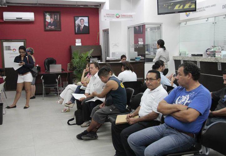 El nuevo punto de cobro de la Tesorería Municipal, en la región 215, recibe, en promedio, a 180 personas al mes. (Tomás Álvarez/SIPSE)