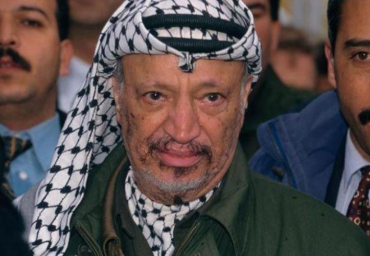 Tras la muerte de Arafat, en 2004, se descubrió material radiactivo en sus ropas. (Archivo Agencias)