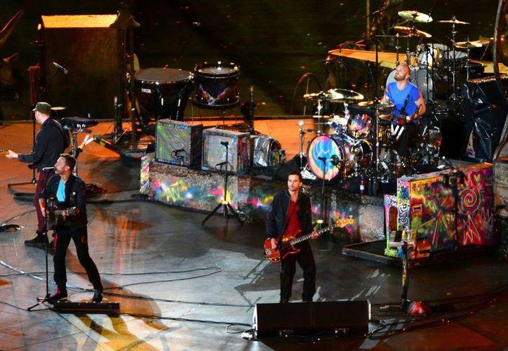 Coldplay durante la Ceremonia de Clausura de los Juegos Paralímpicos Londres 2012. (Archivo Notimex)