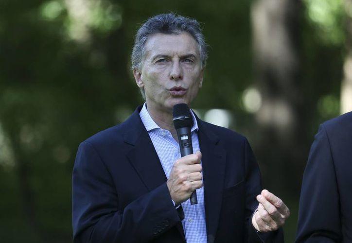 Mauricio Macri asumió la presidencia argentina con la promesa de borrar las huellas de doce años de la administración kirchnerista. (EFE)