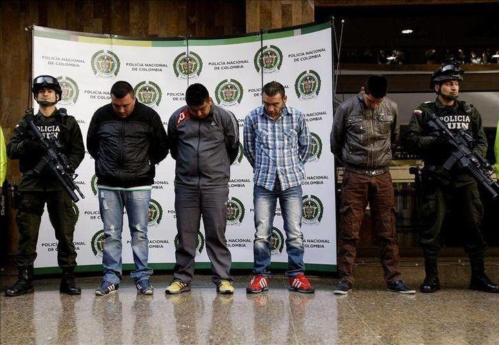 Andrés Oviedo, Héctor López, Julio García, Édgar Bello, Wilson Peralt, Ómar Valdés y Edwin Figueroa son los responsables de la muerte del agente. (EFE).