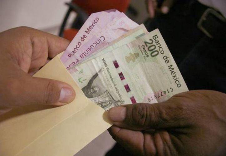 El gobierno federal ve con buenos ojos la discusión sobre el ingreso de las familias mexicanas. (Archivo/SIPSE)