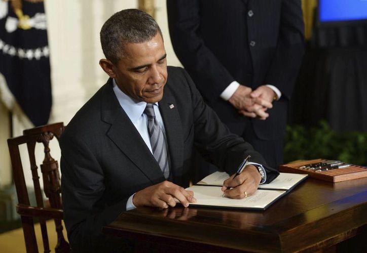 Barack Obama firmó una ley para bloquear a un embajador iraní ante la ONU. (EFE/Archivo)